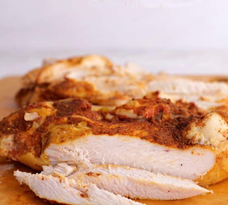 sliced chicken breast on cutting board