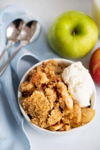 Apple crisp and scoop of vanilla ice cream