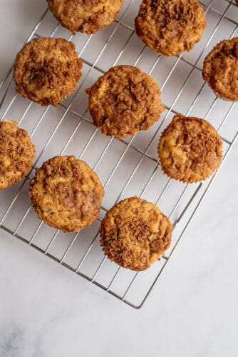 Apple pie muffins on cooling tray.