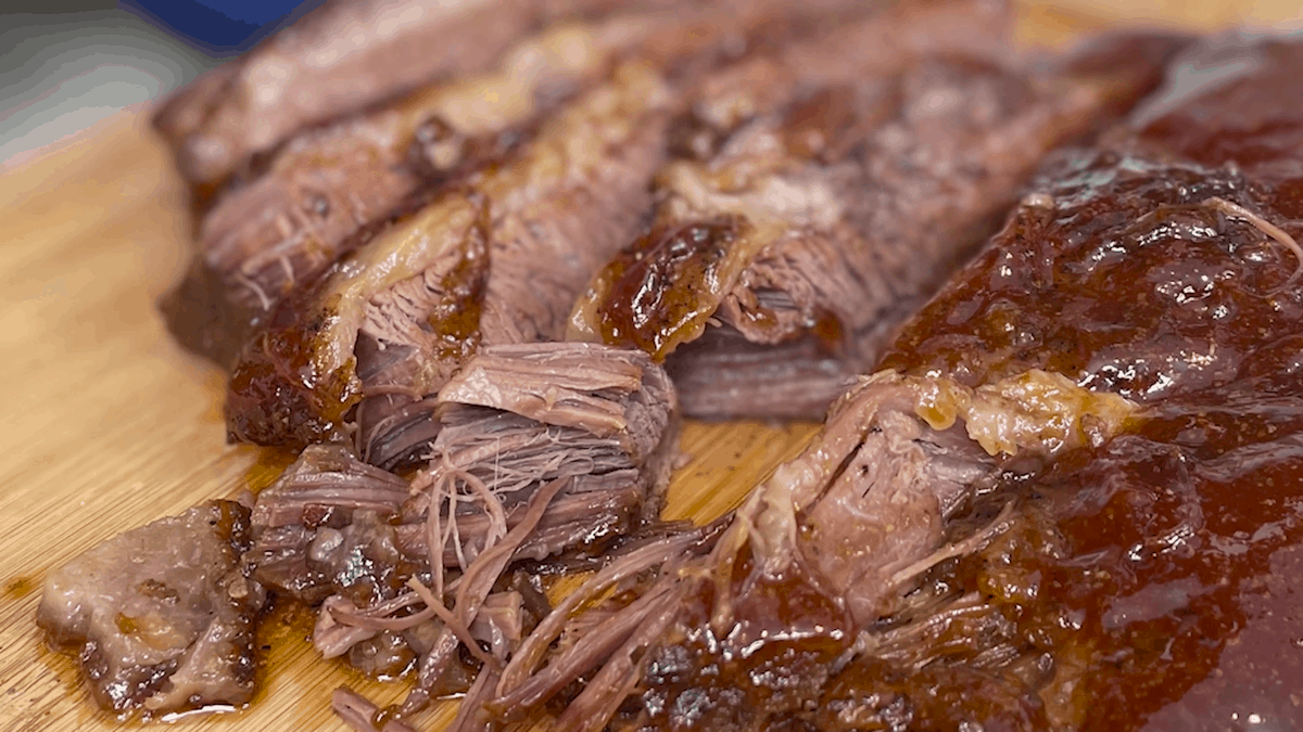 Close-up on slices of beef brisket.