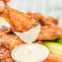 BBQ air fryer chicken wing dipped in ranch dressing.