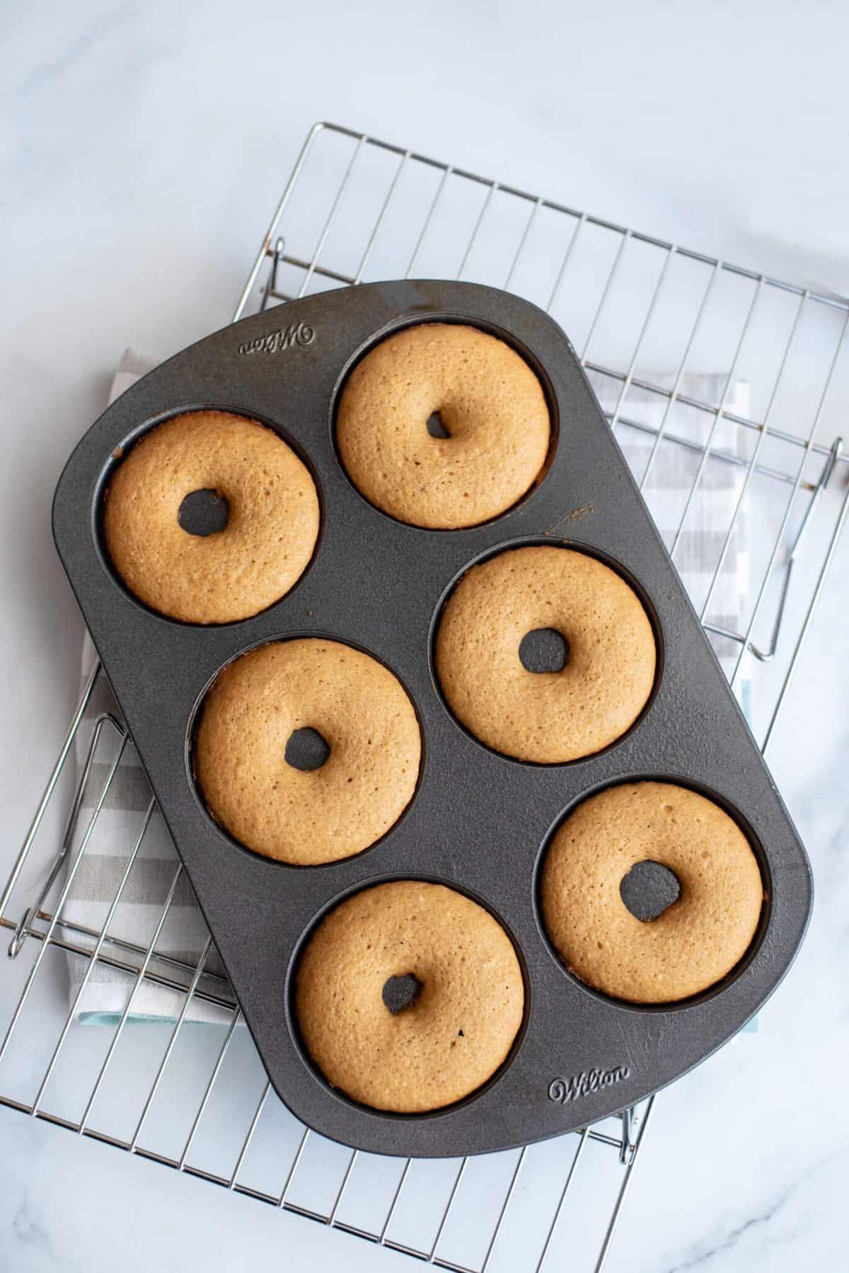 Donut tray of baked donuts.