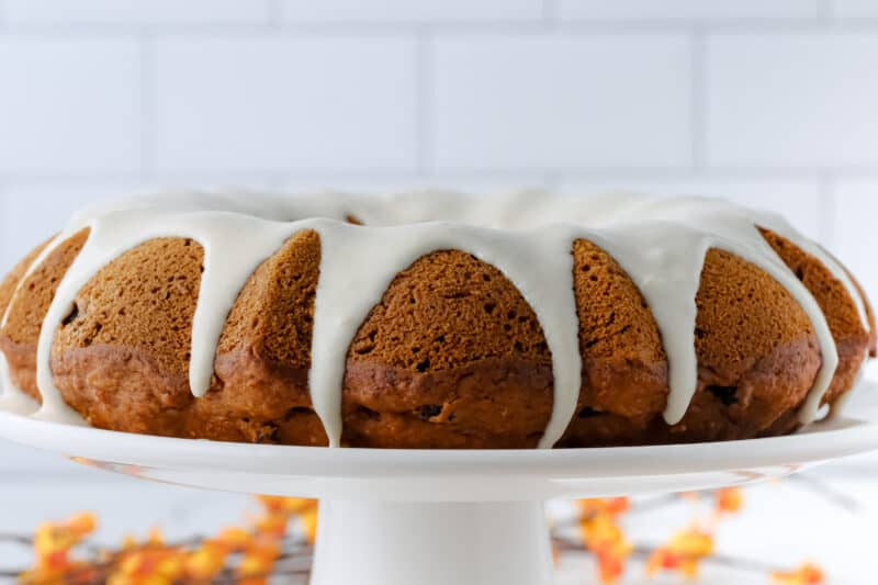 Sweet potato cake with icing running down sides.