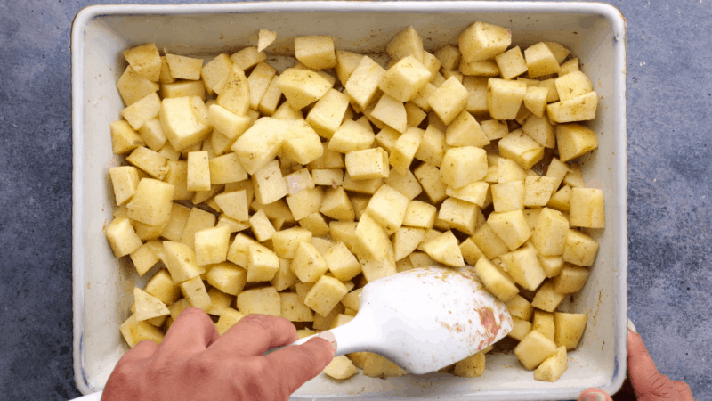 Mixing other ingredients with apples.
