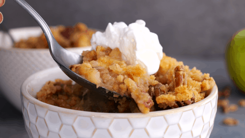 Spoonful of apple crumble.