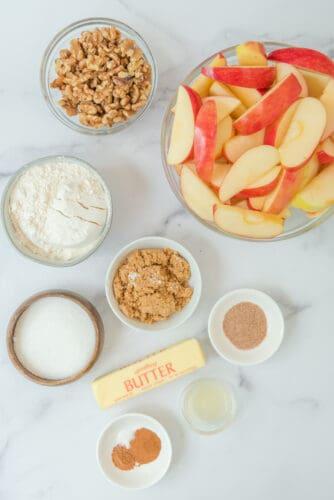 Ingredients for apple crisp in the crockpot.
