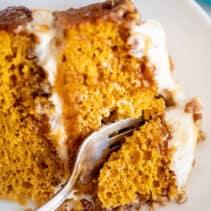 Fork in a slice of pumpkin praline cake.
